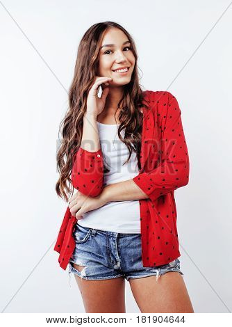 young pretty teenager brunette girl happy smiling emotional posing on white background, lifestyle people concept close up