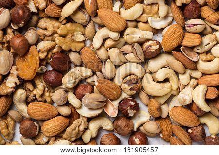 Backround from various kinds of nuts almond walnut hazelnut cashew Brazil nuts