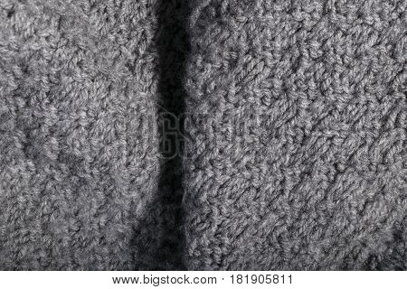 Isolated Handmade Knitted Gray Fabric In Details.