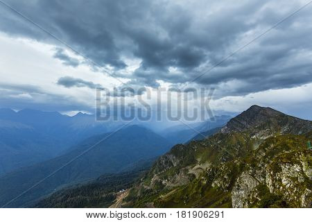 Scenary view of Caucasus mountains with cloduy sky