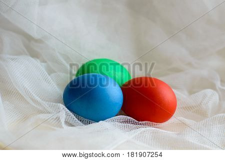 Colored eggs colored on Easter for the lace. Fun colored eggs painted manually. Handmade food on a subtle texture.