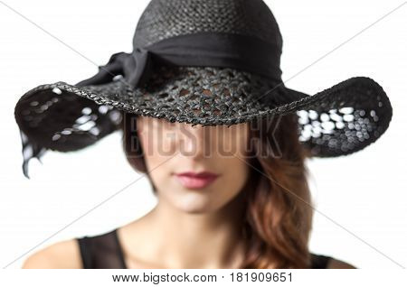 anonymous lady in elegance black hat and deep purple lips isolated on white bakcground
