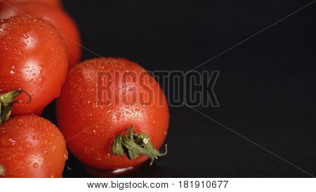 Extreme close-up tomatoes with water drops with copy space. Concept of healthy food.