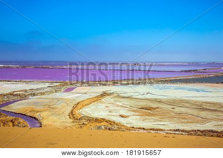 Extraction of ocean salt in Namibia. Multicolored fields for evaporation of water in Walvis Bay. The concept of ecological and exotic tourism
