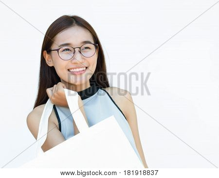 Smiling woman with beautiful isolated on white with Bespectacled and handmade bag for Treat global warming