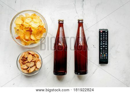 watching movies set with chips and remote control on white background top view mock up