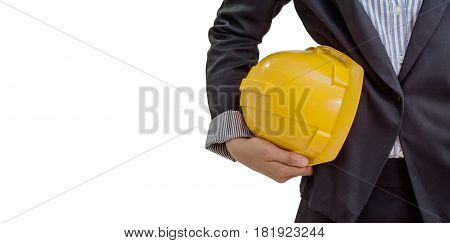 person holding yellow helmet for workers security on white background File contains a clipping path.