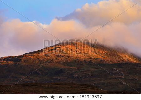 Beautiful mountain peak during sunset with dramatic cloud Isle of Skye Hightland Scotland