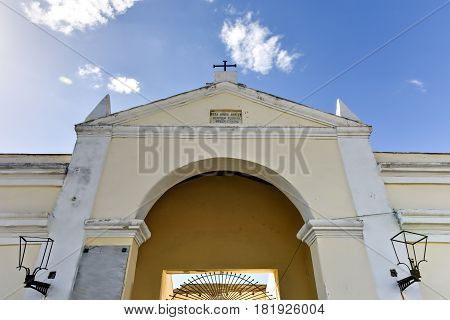 Cienfuegos, Cuba - Jan 13, 2017: Entrance to the Reina Cemetery in Cienfuegos Cuba. This cemetery contains the tombs of Spanish soldiers died during the 19th century freedom fight in Cuba.