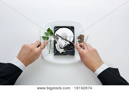 Hard Disk Cut With A Knife Man