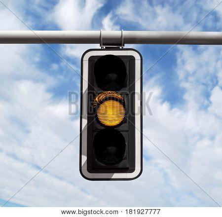 Traffic Light - Yellow Against Sky