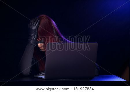 Young girl hacker with laptop