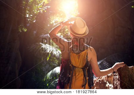 Woman in ravine with palms