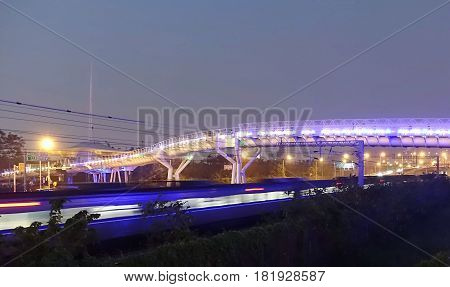 Bicycle Overpass And Passing Train At Night