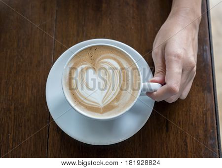 Coffee Latte On Woman Hand In Coffee Shop