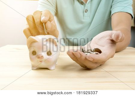 man hand putting mix coins. Business investment growth concept