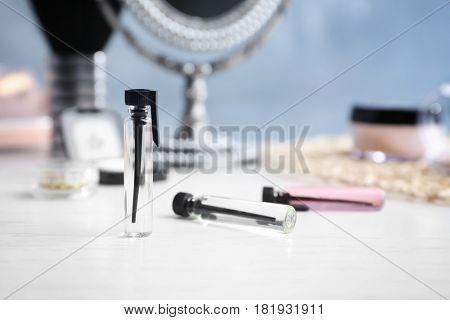 Perfume samples on blurred background