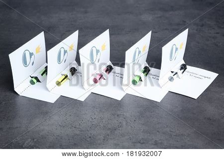 Perfume samples on gray background