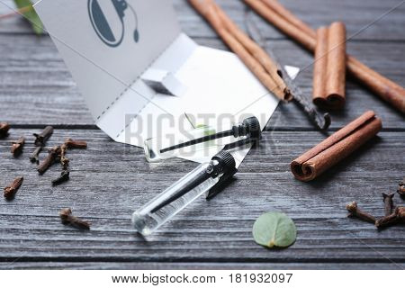 Beautiful composition with perfume samples on wooden background