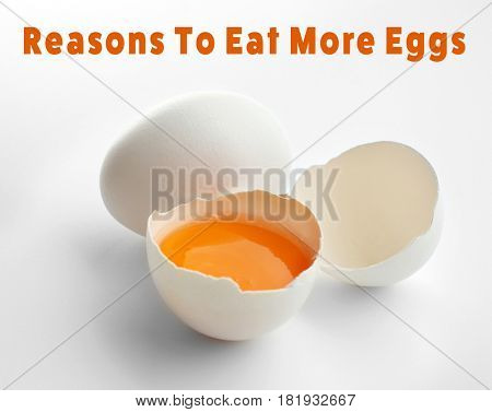 Raw eggs on white background. Text REASONS TO EAT MORE EGGS