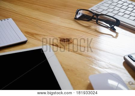 Office Desk Table With Computer, Supplies, Tablet, Calculator, Pen And Glasses .(selective Focus)