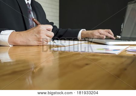 A Businessman Sign Or Discussing Document Or Graph.close Up Shot.