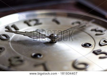 old or retro clock winding close-up hands and face of the old mechanical watches.