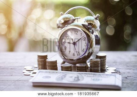 Close Up Of Time And Money With Green Bokeh Background ,business Finance And Money Concept,save Mone