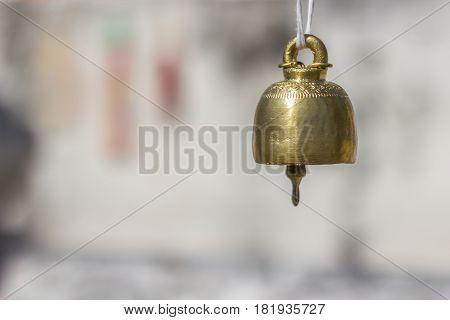 Small bell used for Buddhist ceremony on blur background