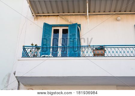balcony railing and beautiful flowers in pots