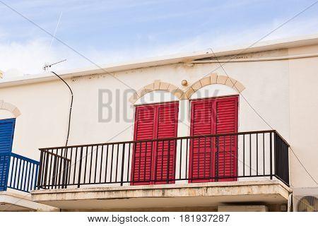 balcony railing. balcony with two red doors