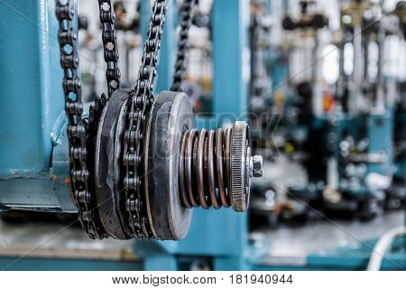 Friction clutch. Chain drive, drive element of braiding machine. Tinted image, Selective focus.