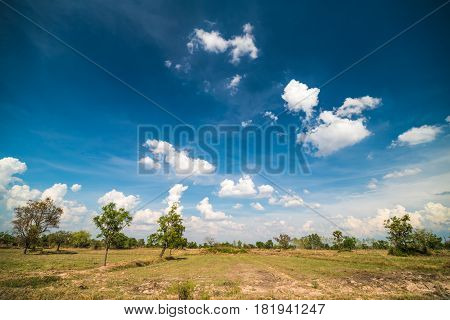 Plowed Field And Cloudy Sky In Sunset