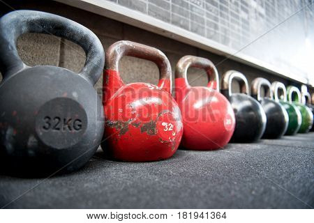 Long Receding Row Of Kettlebell Weights In A Gym