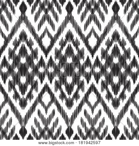 Vector illustration of the black and white colored ikat ornamental seamless pattern. Scribble texture. Chevron design.