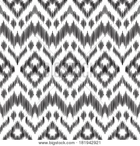 Vector illustration of the black and white colored ikat ornamental seamless pattern. Chevron design. Scribble textured effect. Fashion print in ethnic style.