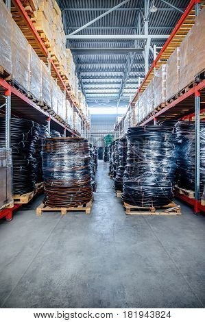 Warehouse industrial and logistics companies. Coiled plastic pipe. Toning the image.