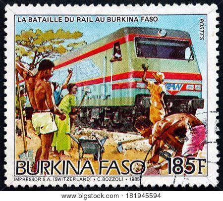 BURKINA FASO - CIRCA 1986: a stamp printed in Burkina Faso shows Diesel Train on New Tracks Railroad Construction circa 1986
