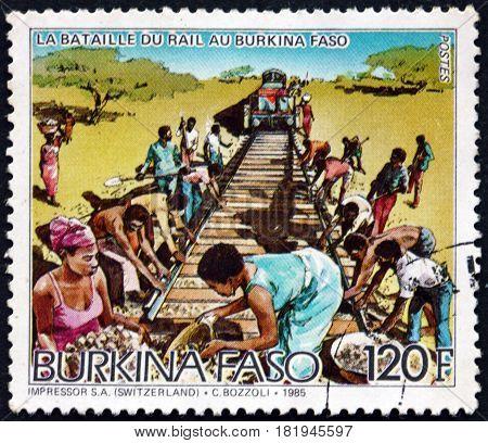 BURKINA FASO - CIRCA 1986: a stamp printed in Burkina Faso shows Laying Rails Railroad Construction circa 1986