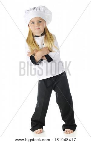 A pretty preschooler barefoot in her chef outfit, looking at the viewer.  On a white background.