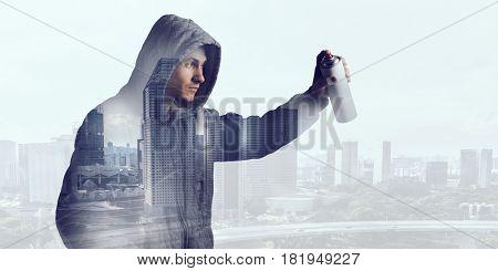 Guy drawing with spray . Mixed media . Mixed media