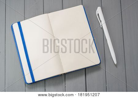 Notepad For Recording On A Wooden Table.