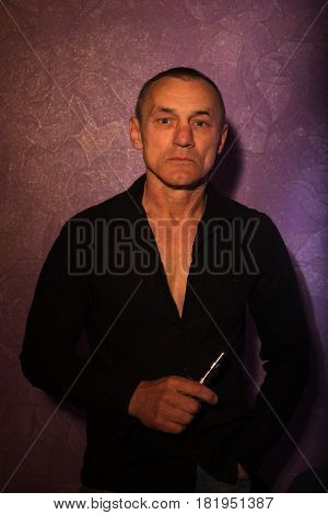 Severe Man Holding Vaporizer In His Hands