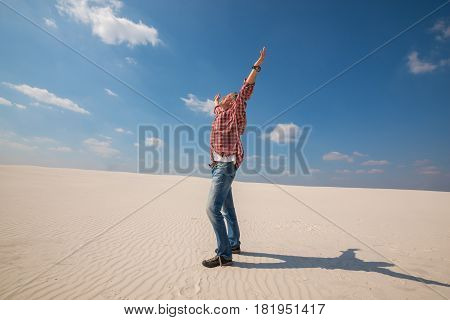 Happy Man, Traveler With Open Arms Enjoying Amazing World In Desert