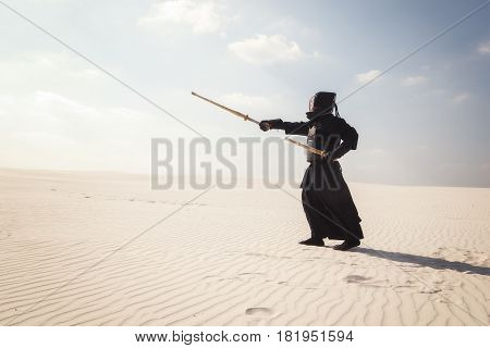 Warrior In Traditional Armor For Kendo Is Training The Right Position With Swords