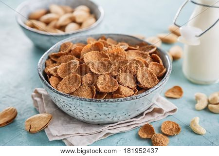 Wheat bran breakfast cereal with milk and nuts. Healthy diet breakfast