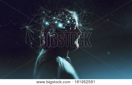 Profile of a bearded mans head with a symbol of neurons in the brain