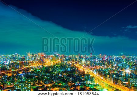 The image of the night city from the height of a bird's flight.A view of the night Osaka.Mnogo houses in iluminatsii.Dark time of the day
