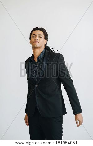Happy Young Businessman In Black Suite