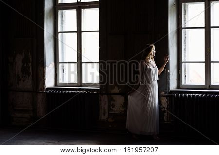 Indoor Summer Portrait Of Young Pretty Cute Girl. Beautiful Woman Posing Beside Two Fairytale Window